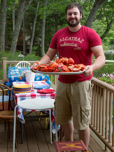 Eben Miller with platter of freshly steamed lobsters