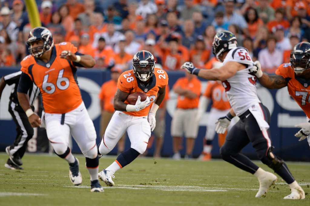 . DENVER, CO - AUGUST 23: Denver Broncos running back Montee Ball (28) picks up a few yards during the first quarter against the Houston Texans August 23, 2014 at Sports Authority Field at Mile High Stadium. (Photo by John Leyba/The Denver Post)
