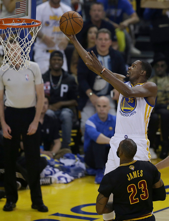 . Golden State Warriors forward Kevin Durant (35) shoots over Cleveland Cavaliers forward LeBron James (23) during the first half of Game 5 of basketball\'s NBA Finals in Oakland, Calif., Monday, June 12, 2017. (AP Photo/Ben Margot)