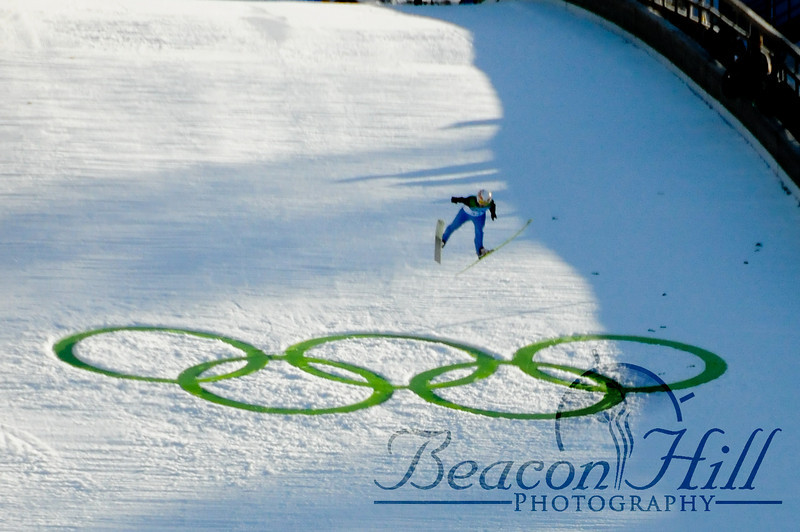 A ski jumper jumps over the Olympic Rings at the large hill ski jump qualifications at Whistler Olympic Park.