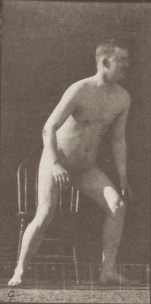 Nude man rising from chair