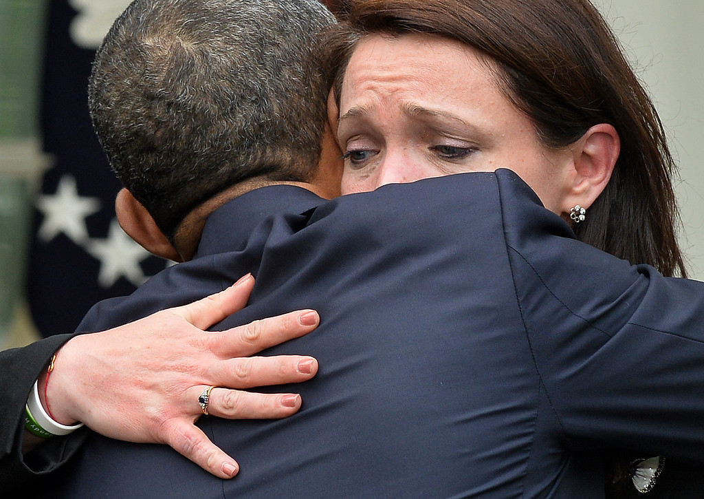 """. US President Barack Obama hugs Nicole Hockley, the mother of Newtown shooting victim Dylan, after speaking on gun control at the Rose Garden of the White House in Washington, DC, on April 17, 2013. Obama on Wednesday slammed what he called a \""""minority\"""" in the US Senate for blocking legislation that would have expanded background checks on those seeking to buy guns. JEWEL SAMAD/AFP/Getty Images"""