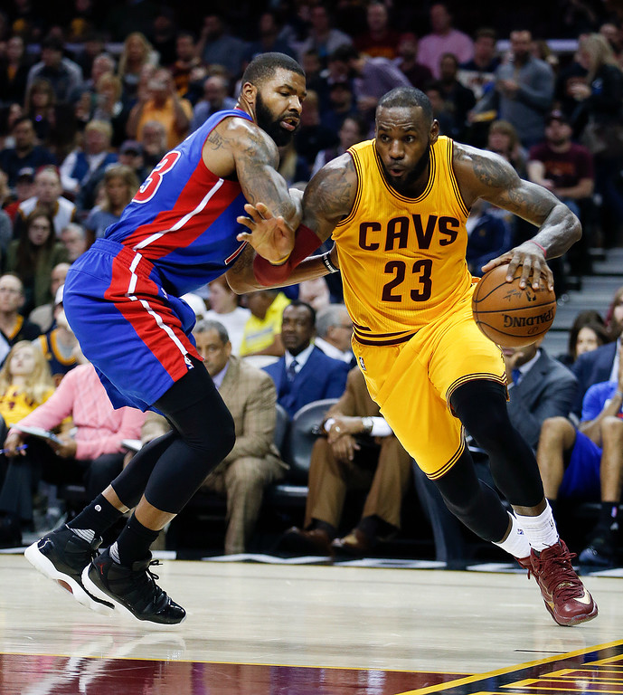 . Cleveland Cavaliers\' LeBron James (23) drives on Detroit Pistons\' Marcus Morris (13) during the second half of an NBA basketball game Friday, Nov. 18, 2016, in Cleveland. The Cavaliers won 104-81. (AP Photo/Ron Schwane)