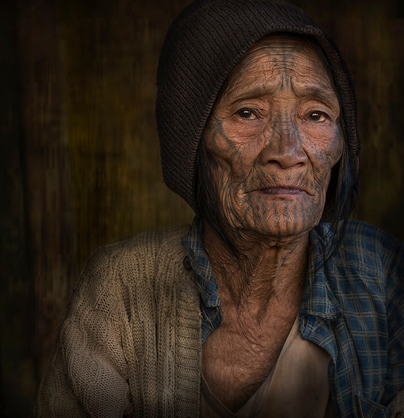 Htein Yaung is over 90 years of age and lives together with her son and his family.  Chin State, Myanmar, 2017
