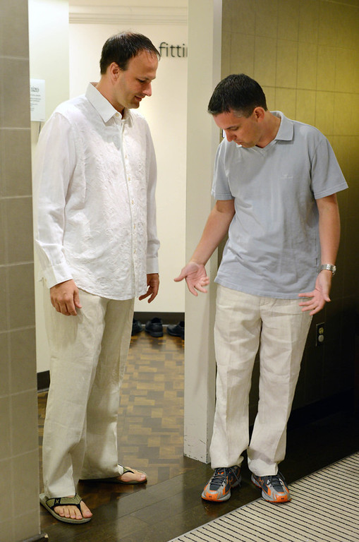 . Brad Weber, left, and Ryan Pfeifle discuss the fit and length of matching linen pants at Macy\'s Mall of America store while shopping for wedding attire.  (Pioneer Press: Chris Polydoroff)