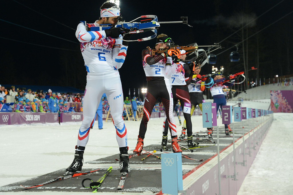 . Gold winner France\'s Martin Fourcade (6) shoots along side Austria\'s Dominik Landertinger (2),Austria\'s Simon Eder (7), Germany\'s Simon Schempp (15) and Norway\'s Ole Einar Bjoerndalen as they compete in the Men\'s Biathlon 12,5 km Pursuit at the Laura Cross-Country Ski and Biathlon Center during the Sochi Winter Olympics on February 10, 2014 in Rosa Khutor near Sochi.  KIRILL KUDRYAVTSEV/AFP/Getty Images