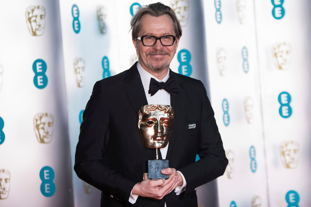 . Actor Gary Oldman poses with his Best Actor Award for \'Darkest Hour\' for photographers upon arrival at the BAFTA 2018 afterparty in London, Sunday, Feb. 18, 2018. (Photo by Vianney Le Caer/Invision/AP)
