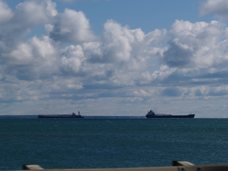 Two freighters - one upbound, one downbound from the car as we cross the Mackinaw Bridge