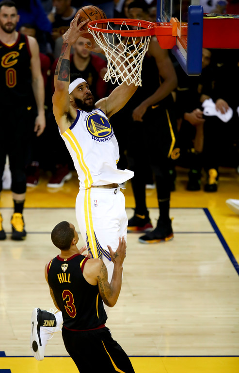 . Golden State Warriors center JaVale McGee (1) dunks over Cleveland Cavaliers guard George Hill (3) during the second half of Game 1 of basketball\'s NBA Finals in Oakland, Calif., Thursday, May 31, 2018. (AP Photo/Ben Margot)
