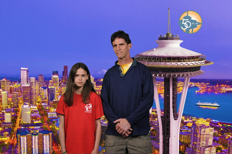 r and I visit the space needle.  she swears that she's smiling.