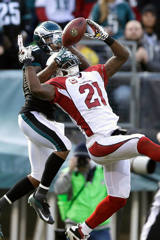 . Arizona Cardinals\' Patrick Peterson, right, breaks up a pass intended for Philadelphia Eagles\' DeSean Jackson during the first half of an NFL football game, Sunday, Dec. 1, 2013, in Philadelphia. (AP Photo/Matt Rourke)