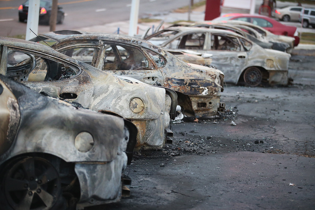 . Cars which were set on fire when rioting erupted following the grand jury announcement in the Michael Brown case sit on a lot on November 25, 2014 in Dellword Missouri. Brown, an 18-year-old black man, was killed by Darren Wilson, a white Ferguson police officer, on August 9. At least 12 buildings were torched and more than 50 people were arrested during the night-long rioting.  (Photo by Scott Olson/Getty Images)