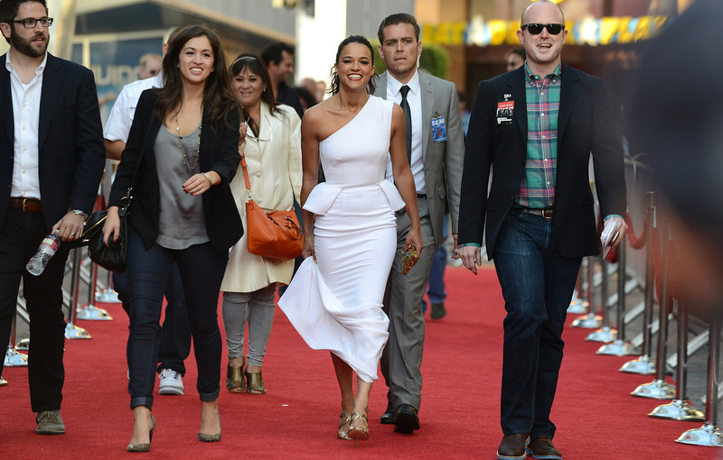 ". Michelle Rodriguez arrives at the LA Premiere of the ""Fast & Furious 6\"" at the Gibson Amphitheatre on Tuesday, May 21, 2013 in Universal City, Calif. (Photo by Jordan Strauss/Invision/AP)"