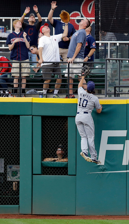 . San Diego Padres\' Hunter Renfroe jumps but can\'t get to a two-run home run by Cleveland Indians\' Jose Ramirez during the first inning of a baseball game, Thursday, July 6, 2017, in Cleveland. (AP Photo/Tony Dejak)