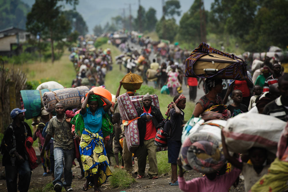 Description of . Thousands of Congolese flee the town of Sake, 26km west of Goma, following fresh fighting in the eastern Democratic Republic of the Congo town on November 22, 2012. Fighting broke out this afternoon causing people to flee the town and head east, towards Goma, to the camps for the internally displaced in the village of Mugunga. AFP PHOTO/PHIL MOORE/AFP/Getty Images