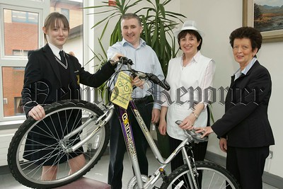 Mrs Elizabeth O'Brien and Mrs Ann Kearney from Our Lady's G.S. with Brendan O'Hare from Bridge End Cycles presenting the school's under 16 Healthy eating competition winner Emma O'Dwyer with a brand New Bicycle. 06W21N19