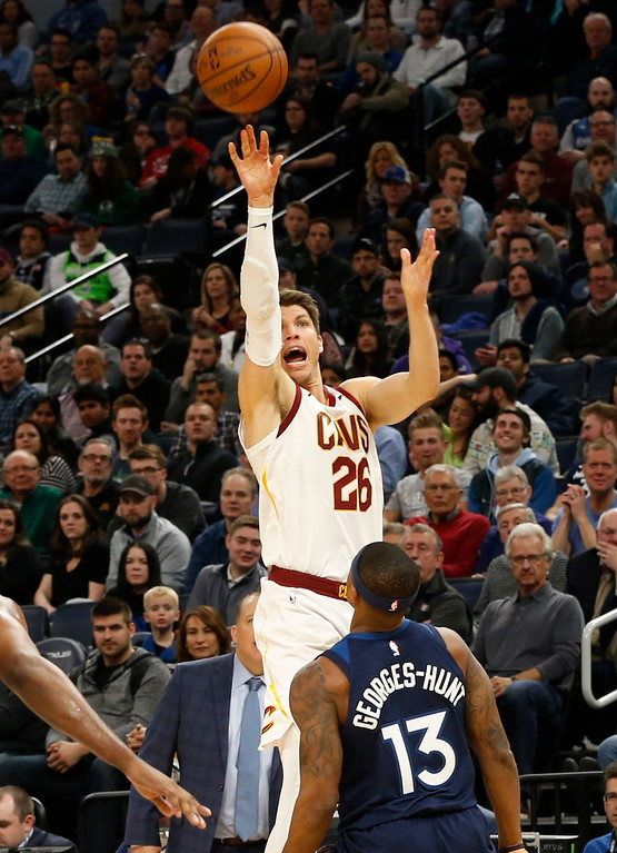 . Cleveland Cavaliers\' Kyle Korver, top, shoots over Minnesota Timberwolves\' Marcus Georges-Hunt in the second half of an NBA basketball game Monday, Jan. 8, 2018, in Minneapolis. (AP Photo/Jim Mone)