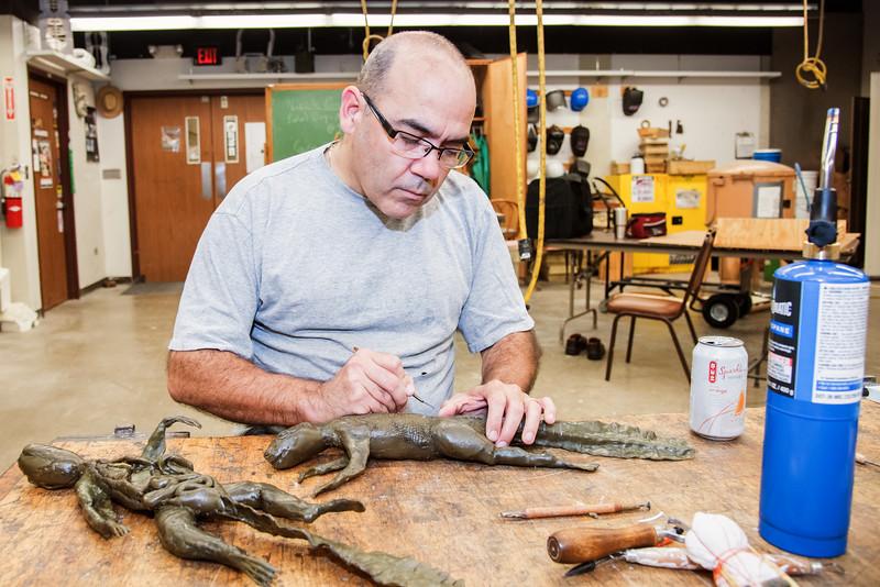 Graduate student, Trent Thigpen working on his MFA sculpture.