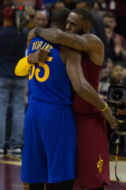. LeBron James (23) of the Cleveland Cavaliers hugs Kevin Durant (35) of the Golden State Warriors prior to the start of an NBA game at the Quicken Loans Arena on Chritmas day.  The Cavs defeated the Warriors 109-108.  Michael Johnson - The News Herald
