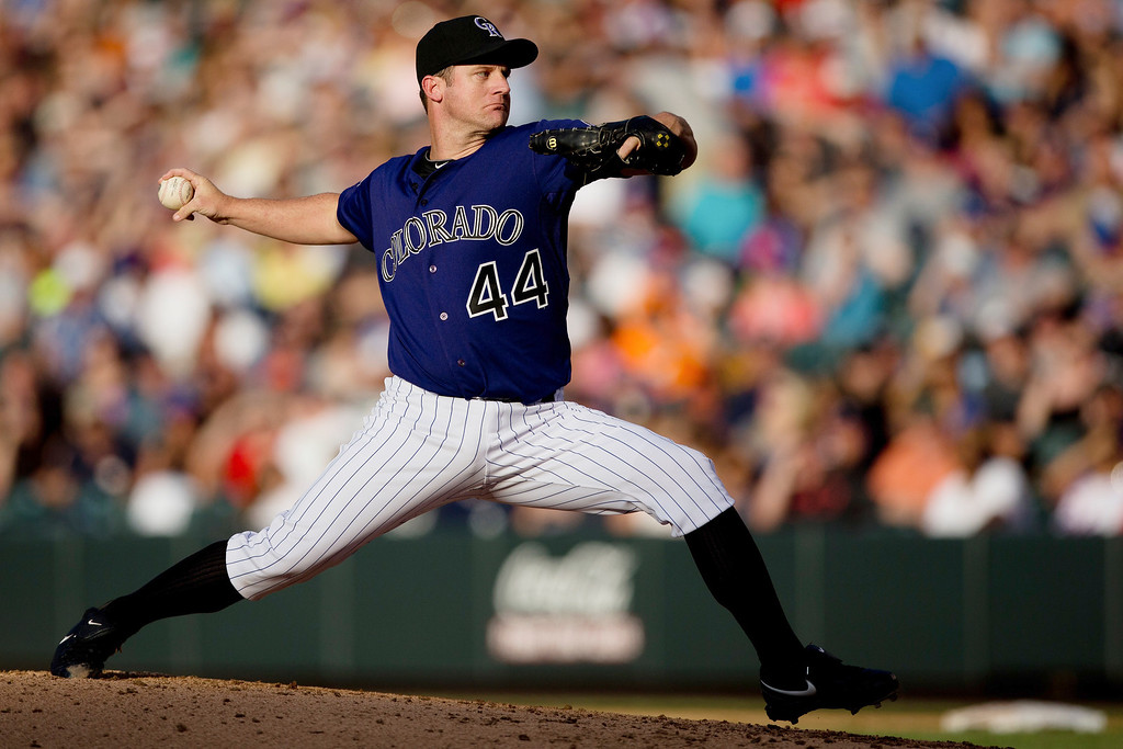 . Starting pitcher Roy Oswalt #44 of the Colorado Rockies delivers to home plate during the second inning against the Los Angeles Dodgers at Coors Field on July 2, 2013 in Denver, Colorado.  (Photo by Justin Edmonds/Getty Images)