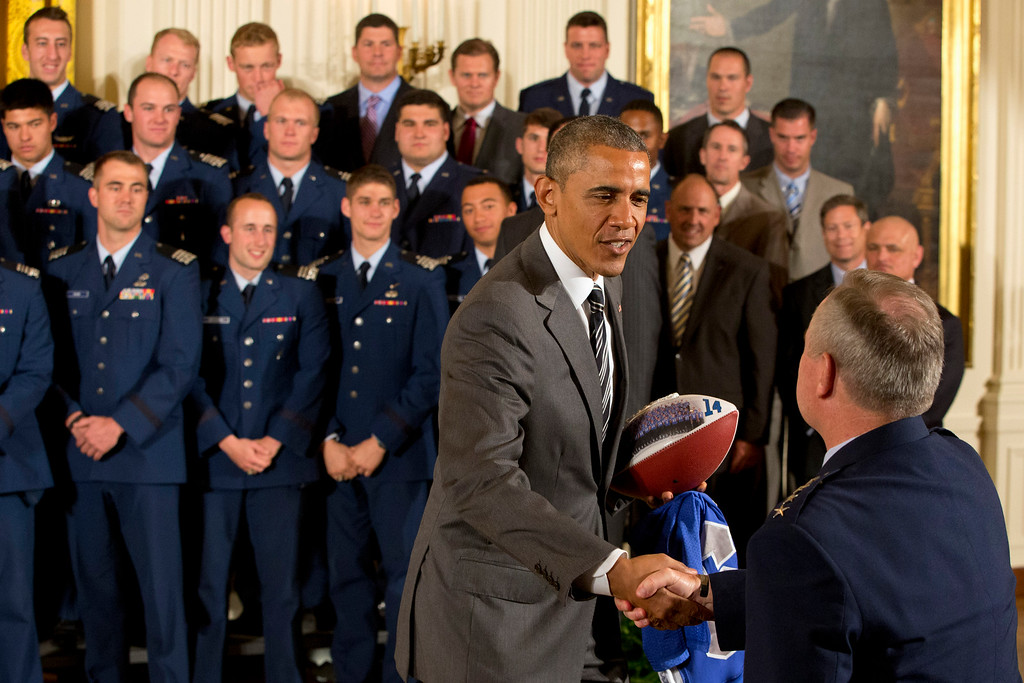 . President Barack Obama greets Air Force Chief of Staff Gen. Mark Welsh, III in the East Room of the White House in Washington, Thursday, May 7, 2015, during an event where the president honored the U.S. Air Force Academy football team with the Commander-in-Chief Trophy. (AP Photo/Jacquelyn Martin)