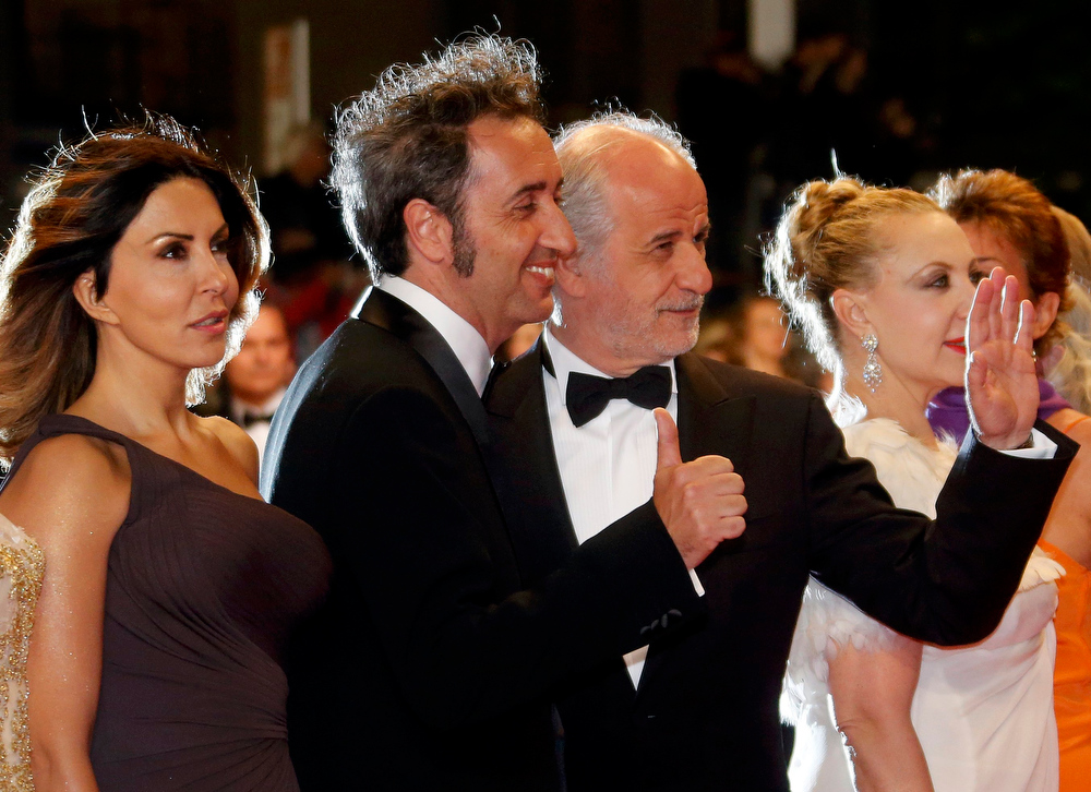 ". Director Paolo Sorrentino (C) pose with cast members Toni Servillo (R) and Sabrina Ferilli (L) pose on the red carpet as they arrive for the screening of the film ""La grande bellezza\"" (The Great Beauty) in competition during the 66th Cannes Film Festival in Cannes May 21, 2013.      REUTERS/Jean-Paul Pelissier"