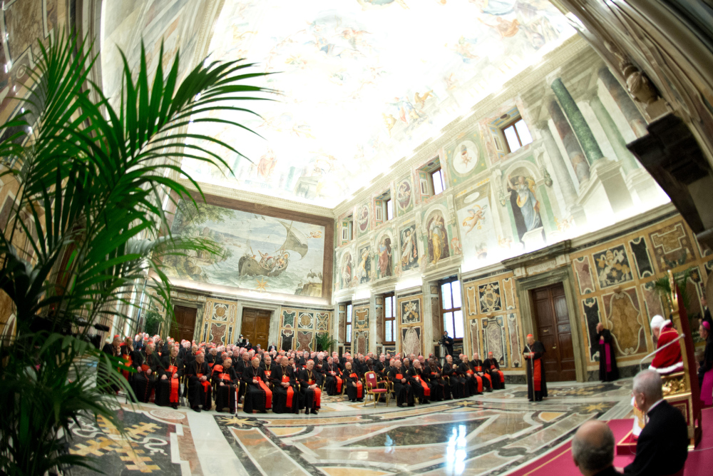 ". In this photo provided by the Vatican newspaper L\'Osservatore Romano, Pope Benedict XVI, top center, delivers his message on the occasion of his farewell meeting to cardinals, at the Vatican, Thursday, Feb. 28, 2013. Benedict XVI promised his ""unconditional reverence and obedience\"" to his successor in his final words to his cardinals Thursday, a poignant farewell before he becomes the first pope in 600 years to resign. (AP Photo/L\'Osservatore Romano, ho)"