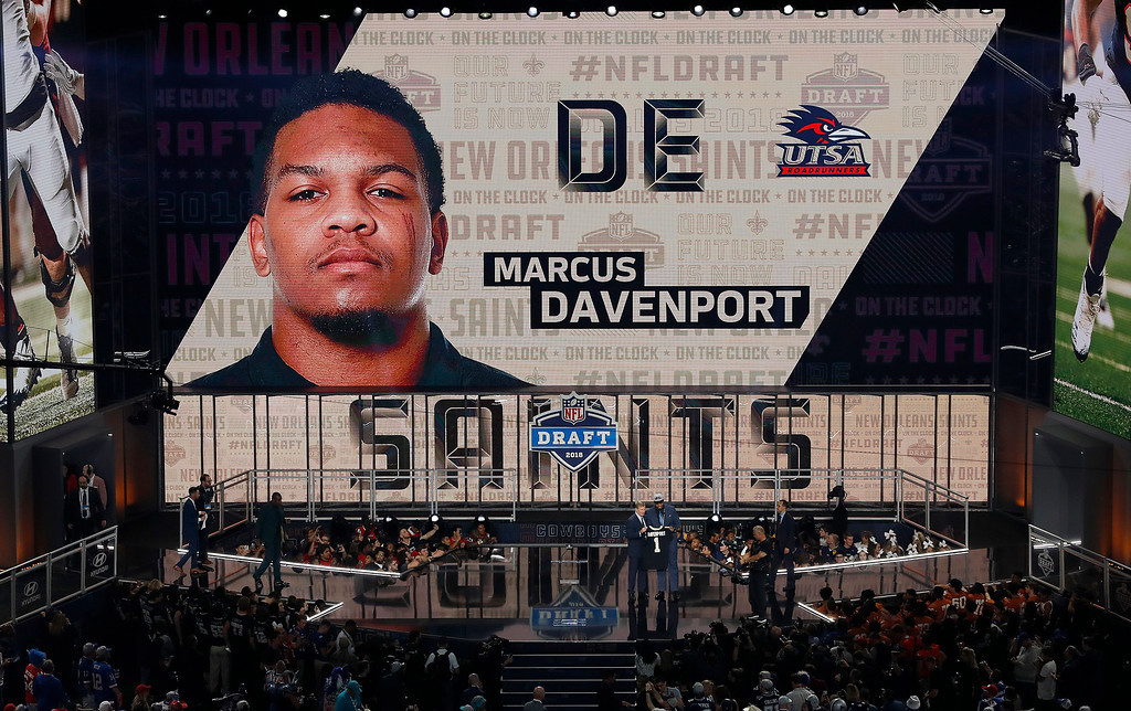 . Commissioner Roger Goodell presents UTSA\'s Marcus Davenport with his New Orleans Saints jersey during the first round of the NFL football draft, Thursday, April 26, 2018, in Arlington, Texas. (AP Photo/David J. Phillip)