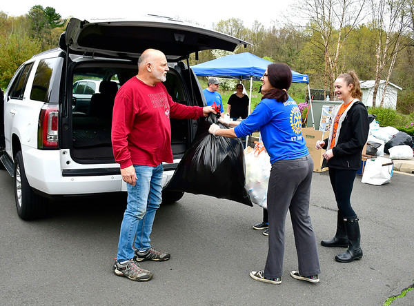 5/4/2019 Mike Orazzi | Staff Fred Fitzgerald hands off bottles and can to Patti Philippon and Ashely Watson during the Bristol Rotary Club's drive held at the Harry C. Barnes Memorial Nature Center on Shrub Road in Bristol Saturday morning.