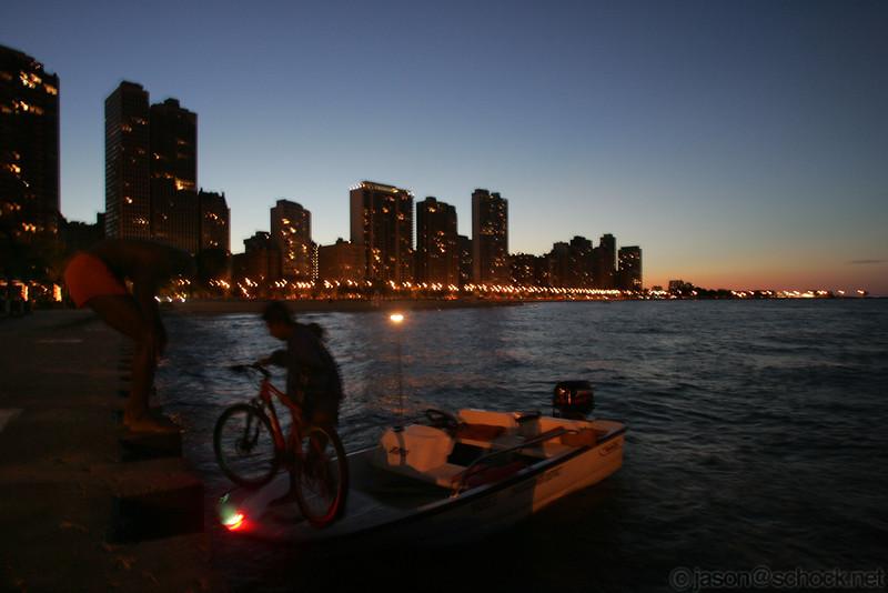Loading a bike on a boat near Oak Street Beach