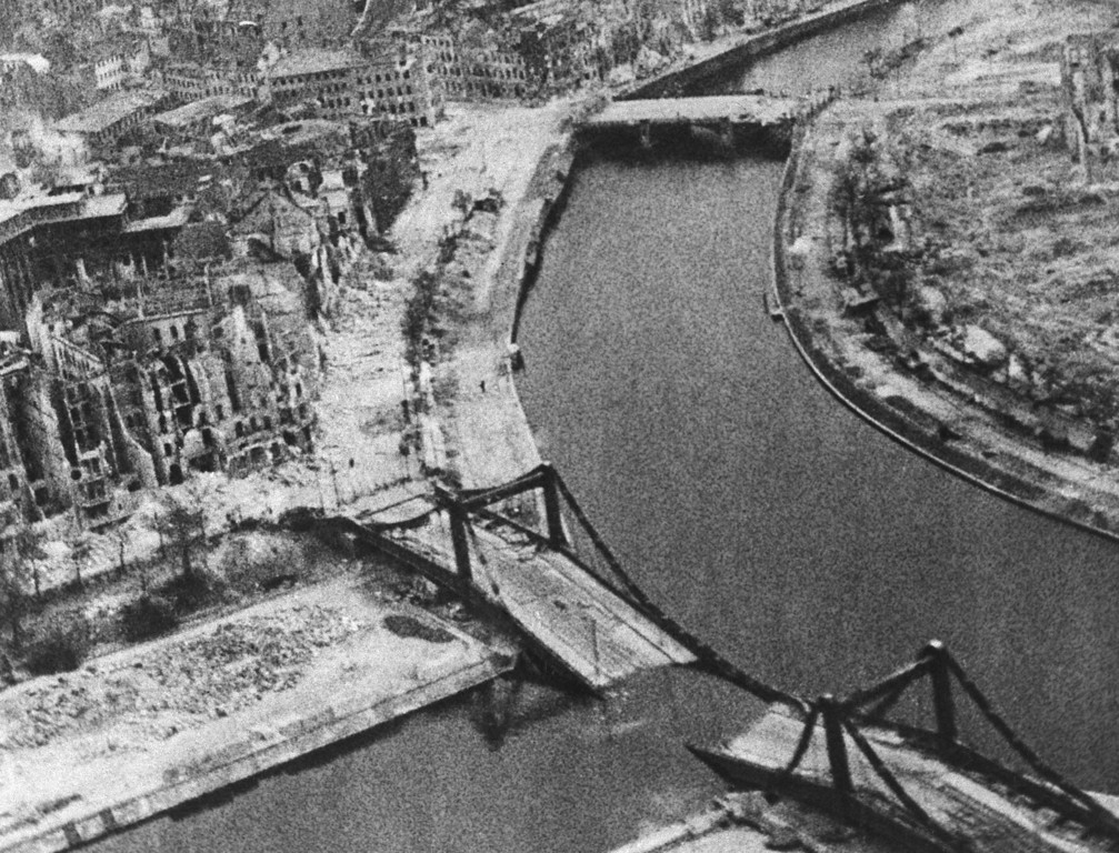 . In this British Official Photo, taken by a low-flying Mosquito of the RAF Film Production Unit, a smashed bridge over the Spree in a heavily-damaged area in Berlin on May 7, 1945. (AP Photo/British Official Photo)