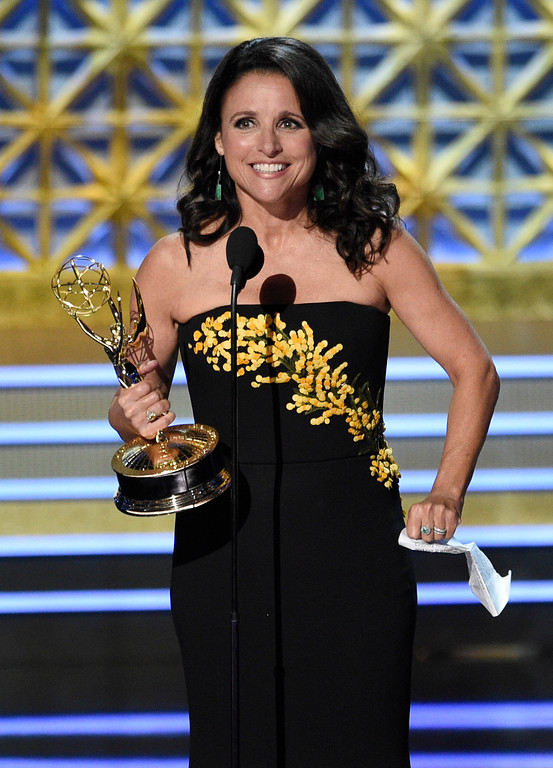 ". Julia Louis-Dreyfus accepts the award for outstanding lead actress in a comedy series for ""Veep\"" at the 69th Primetime Emmy Awards on Sunday, Sept. 17, 2017, at the Microsoft Theater in Los Angeles. (Photo by Chris Pizzello/Invision/AP)"