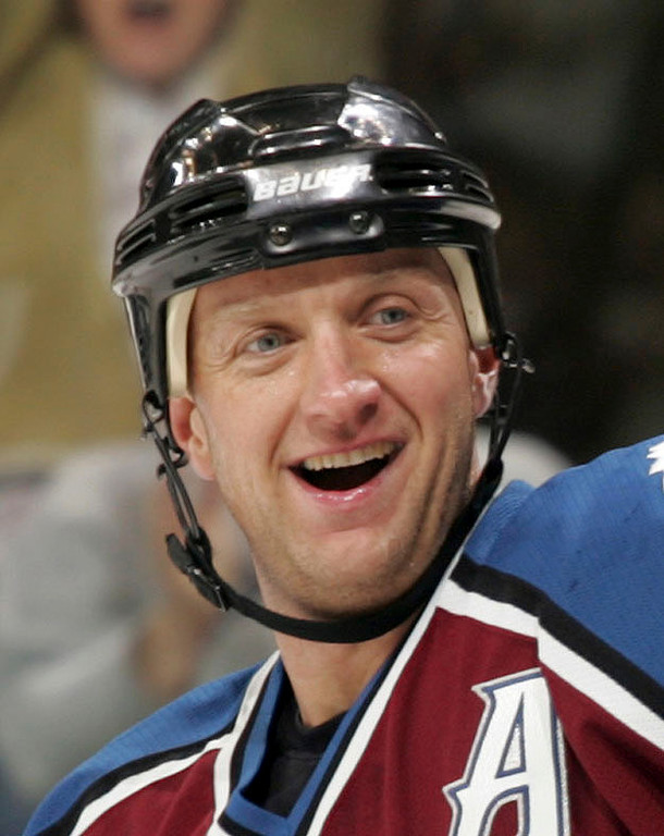 . Colorado Avalanche defenseman Rob Blake smiles at teammates after scoring his 200th career goal against the Chicago Blackhawks in the third period of a hockey game in Denver, Monday, April 3, 2006. Blake returned to his first NHL team Saturday, July 1, 2006, after signing a two-year deal with the Los Angeles Kings. (AP Photo/Jack Dempsey,file)