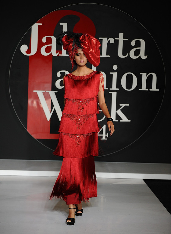 . A model showcases designs by Watchara of Thailand on the runway during Jakarta Fashion Week 2014 at Senayan City on October 21, 2013 in Jakarta, Indonesia.  (Photo by Robertus Pudyanto/Getty Images)