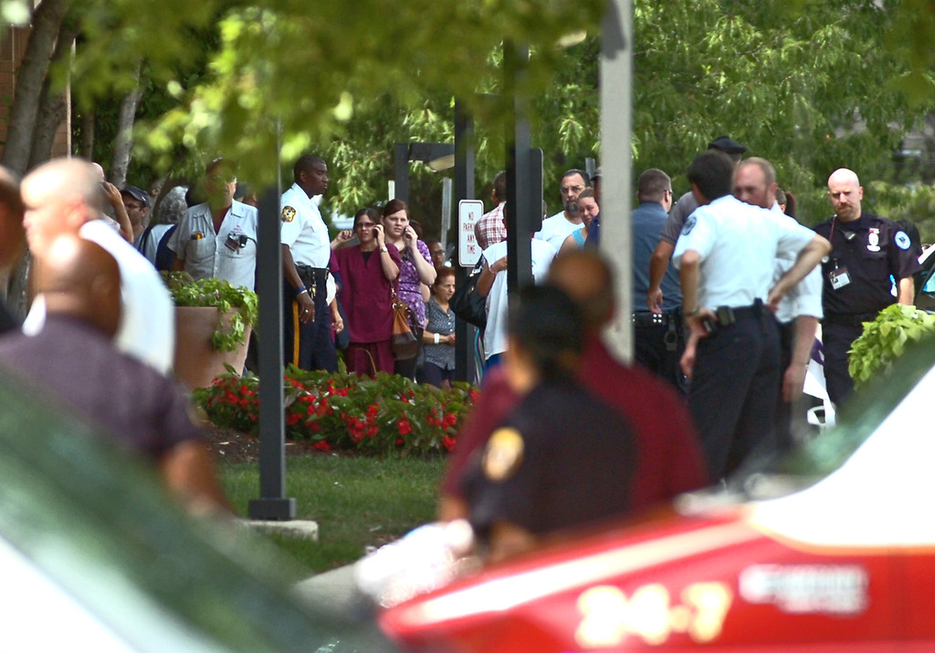 . People are evacuated after police say a man opened fire in the Sister Marie Lenahan Wellness Center in Yeadon on the campus of Mercy Fitzgerald Hospital Thursday. (Times Staff / JULIA WILKINSON)
