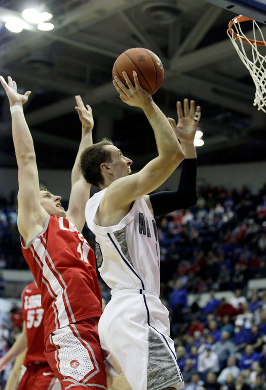 . Air Force\'s Mike Fitzgerald shoots, covered by New Mexico\'s Cameron Bairstow during the second half of an NCAA college basketball game, in Air Force Academy, Colo., Saturday March 9, 2013. Air Force beat New Mexico 89-88. (AP Photo/Brennan Linsley)