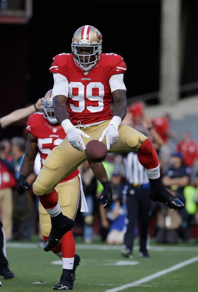 . 49ers linebacker Aldon Smith celebrates after recovering a fumble by Vikings quarterback Christian Ponder during the first quarter. (AP Photo/Jeff Chiu)