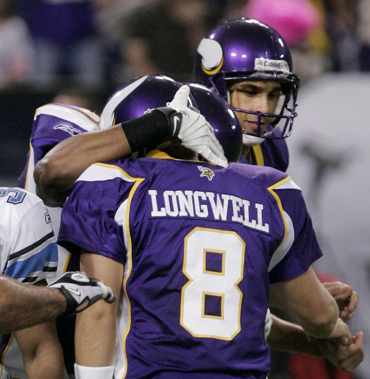 . Vikings holder Chris Kluwe, right, congratulates kicker Ryan Longwell after his go-ahead field goal with 9 seconds left as the Vikings beat the Detroit Lions 12-10 on Sunday, Oct. 12, 2008, in Minneapolis. (AP Photo/Jim Mone)