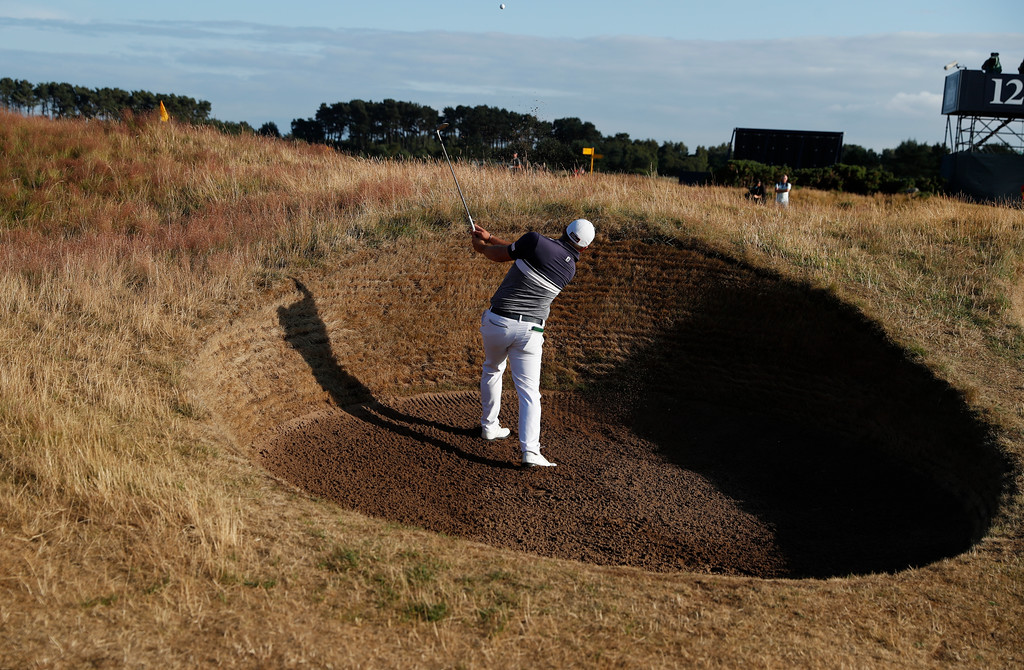 . Zander Lombard of South Africa plays our of a bunker on the 12th hole during the second round of the British Open Golf Championship in Carnoustie, Scotland, Friday July 20, 2018. (AP Photo/Alastair Grant)