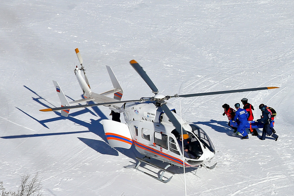 . Alexandra Coletti of Monaco is carried to a helicopter after a crash during the Alpine Skiing Women\'s Downhill on day 5 of the Sochi 2014 Winter Olympics at Rosa Khutor Alpine Center on February 12, 2014 in Sochi, Russia.  (Photo by Alexander Hassenstein/Getty Images)