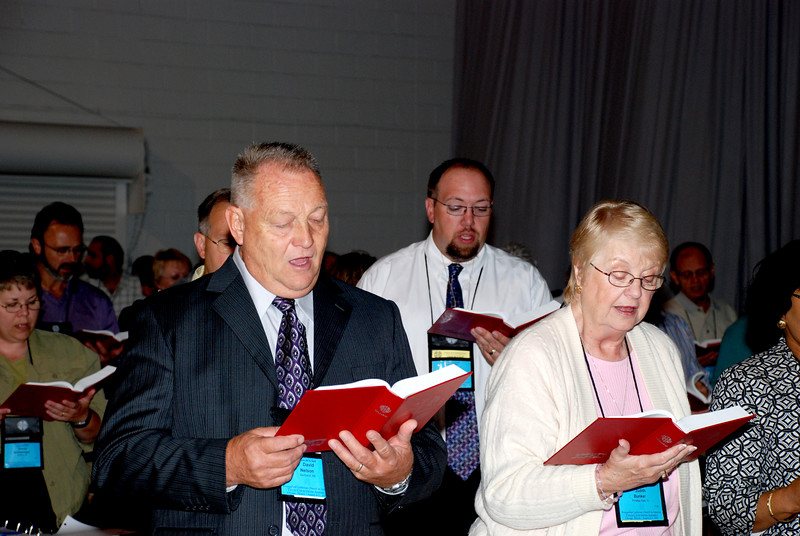 Voting Members singing at Tuesday's Plenary meeting.