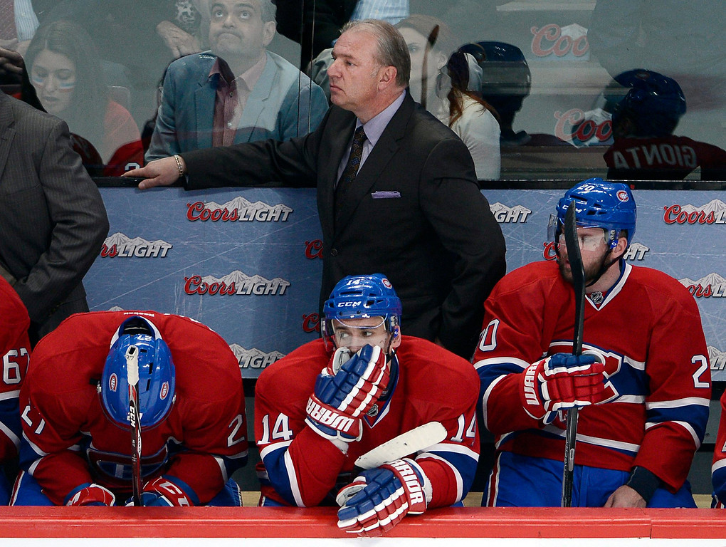 . Montreal Canadiens head coach Michel Therrien and players Alex Galchenyuk, from left, Tomas Plekanec and Thomas Vanek, right, watch the final minutes of the third period as they lose 3-1 to the New York Rangers in Game 2 of the NHL hockey Eastern Conference final Stanley Cup playoff series Monday, May 19, 2014, in Montreal. (AP Photo/The Canadian Press, Ryan Remiorz)
