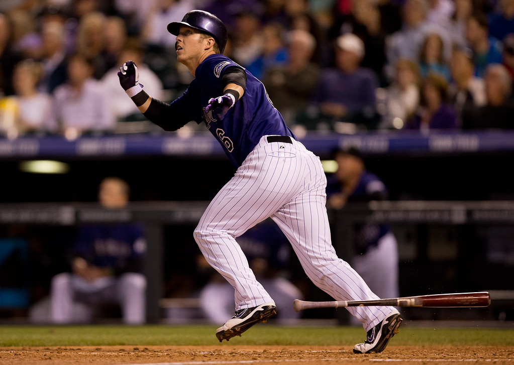 . Corey Dickerson #6 of the Colorado Rockies watches his solo home run during the seventh inning against the Atlanta Braves at Coors Field on June 9, 2014 in Denver, Colorado.  (Photo by Justin Edmonds/Getty Images)