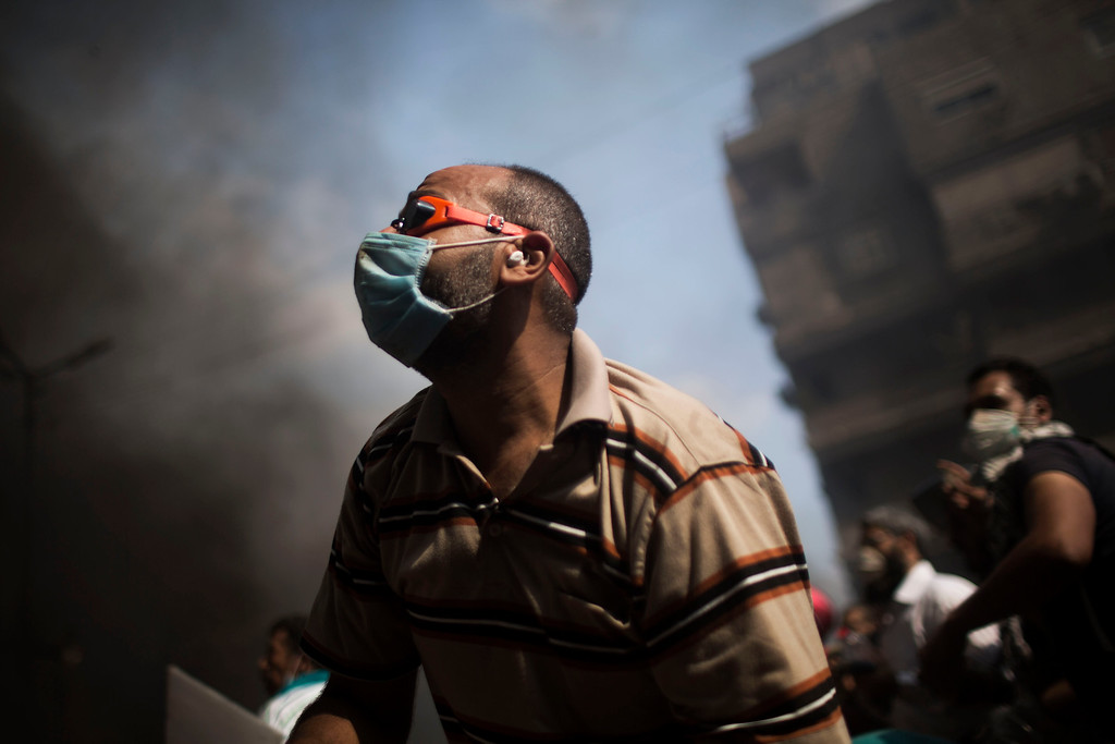 . Supporters of ousted Egyptian President Mohammed Morsi clash with security forces in Cairo\'s Nasr City district, Egypt, Wednesday, Aug. 14, 2013.  (AP Photo/Manu Brabo)