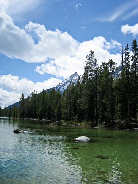 Big white rock in the clear waters of String Lake