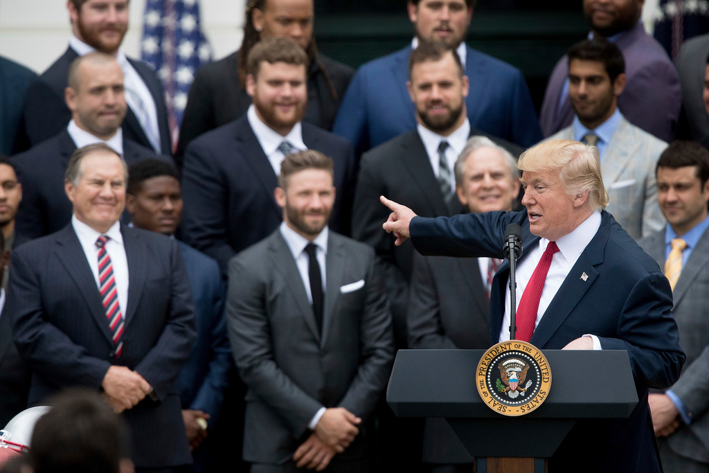 . President Donald Trump points to New England Patriots head coach Bill Belichick, left, during a ceremony on the South Lawn of the White House in Washington, Wednesday, April 19, 2017, where he honored the Super Bowl Champion New England Patriots for their Super Bowl LI victory. (AP Photo/Andrew Harnik)
