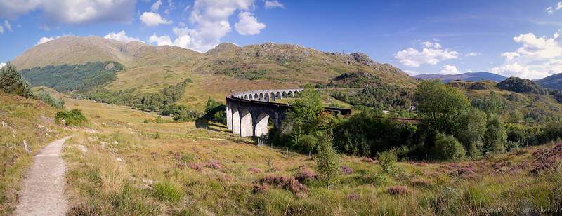 """Glenfinnan Viaduct, featured in several Harry Potter movies. A """"Hogwarts Express""""-style steam train still runs thru here twice a day, between Mallaig and Fort William, Scotland."""