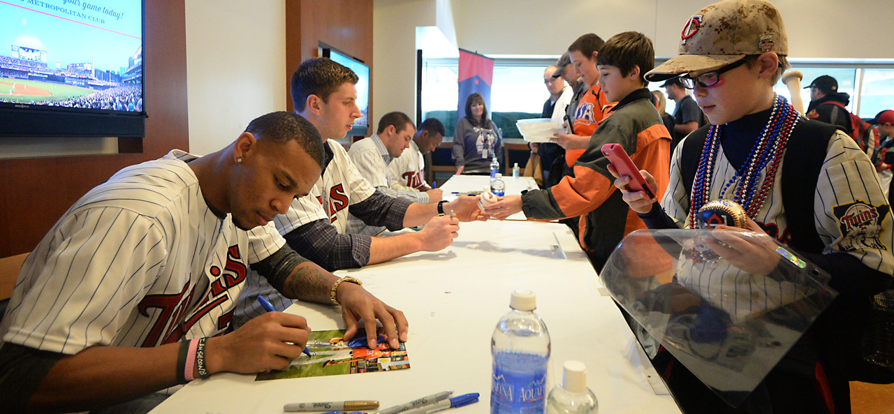 . Ten year-old Austin Kowski of Sauk Center gets a photo of Twins phenom Bryon Buxton while also getting his autograph at Twinsfest at Target Field, Saturday, January 25, 2014(Pioneer Press: John Autey)