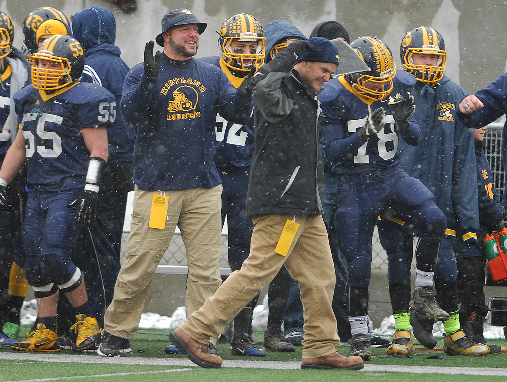 . Michael Allen Blair/ MBlair@News-Herald.com Kirtland head coach Tiger Laverde celebrates Kirtlsand\'s fourth touchdown during the second quarter of Friday\'s Div VI state championship victory over Wayne Trace at Fawcett Stadium in Canton.
