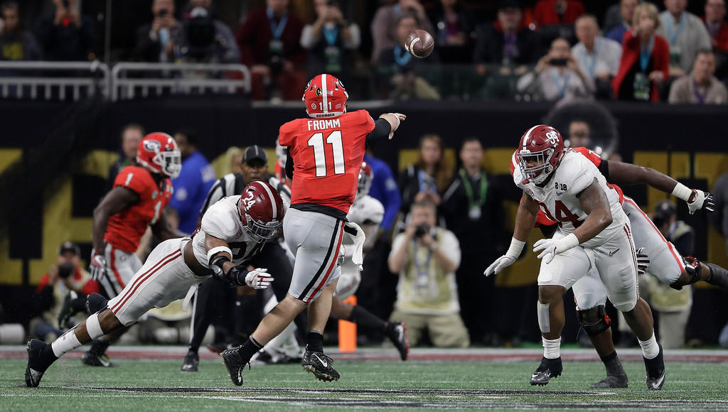 . Georgia quarterback Jake Frommthrows during the first half of the NCAA college football playoff championship game against Alabama Monday, Jan. 8, 2018, in Atlanta. (AP Photo/David J. Phillip)